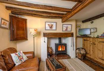 The open plan ground floor has a wood-burning stove and so much character.