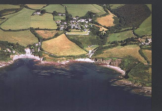 An aerial photograph of Talland Bay, with the beach on the left a quarter of a mile down the hill from Maryland.