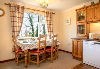 The kitchen/dining-room, where you can enjoy more of those wonderful views.