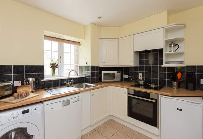 The kitchen is fitted around three sides of this room and so is a very practical and open space.