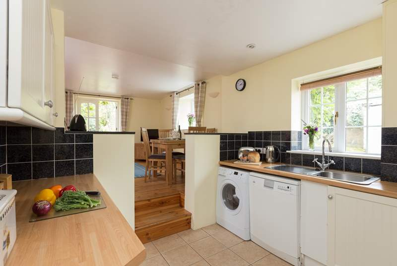 The kitchen is part of the open plan layout and accessed by steps down.  The kitchen is well is equipped to cook up a storm or the holiday fry up!