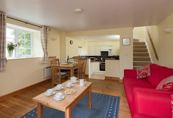 The ground floor is a cheerful open plan layout, with steps down to the kitchen-area.
