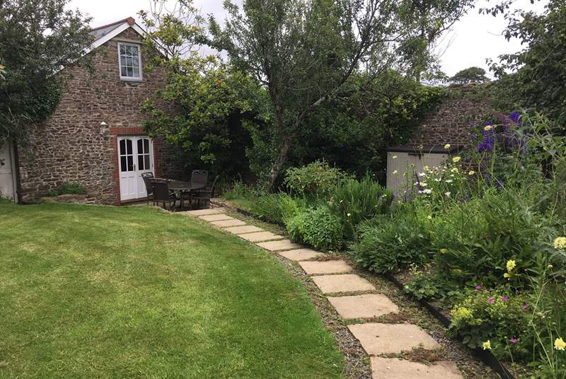 Fig Tree Cottage is in its own private walled garden, a magical place to rewind after a day of exploring.