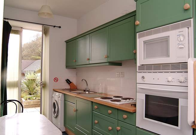 The beautifully fitted kitchen-area leads out onto the patio.