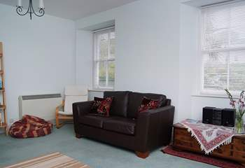 The sitting-room is spacious and bright.