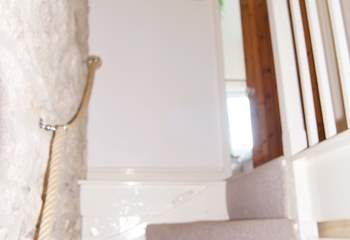 Please note there is a steep and narrow stairway which leads from the kitchen to the bedrooms above.