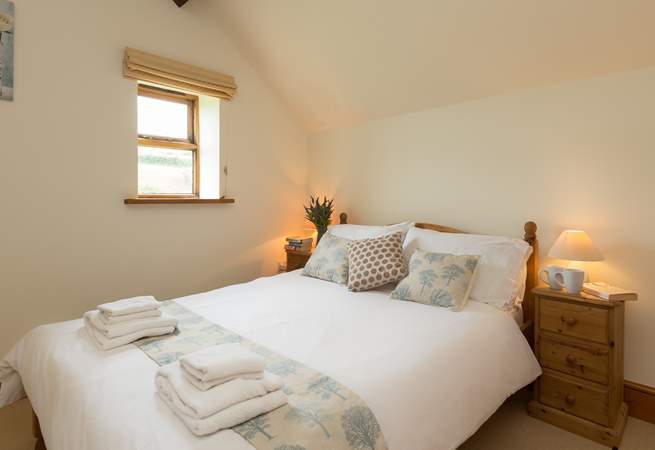 The room is bright and airy with views over the fields.