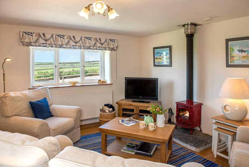 The open plan living space has lovely views towards Gunwalloe.