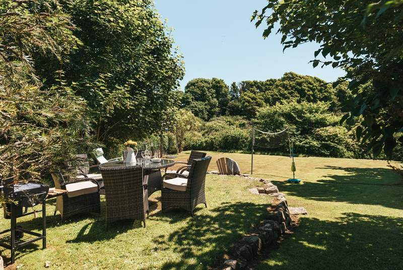The garden is a short walk across the courtyard and has space to play and space to dine outside. Please note, the rattan garden furniture is available Easter to October.