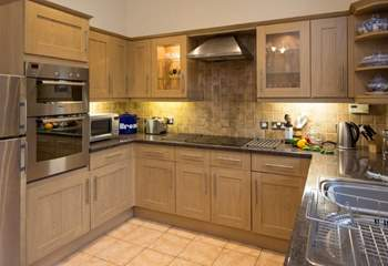 There is plenty of space in the kitchen.