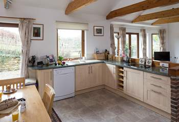 The kitchen is fully equipped and creates a very sociable open space.