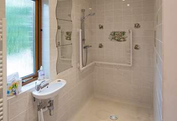 The large wet-room can be accessed via the bathroom, or directly from the hallway.