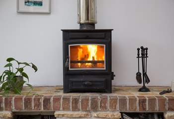 The cosy wood-burner, perfect for a snug night in.