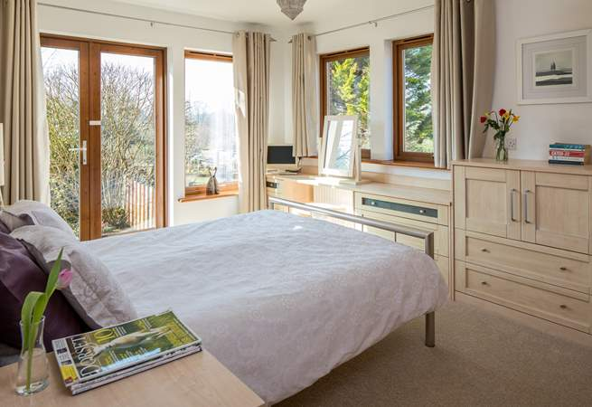 The master en-suite bedroom has French doors leading out onto the rear terrrace.