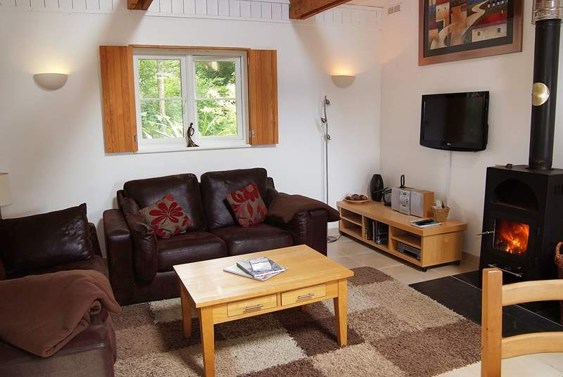 The sofas in the sitting-area surround the cosy wood-burner.