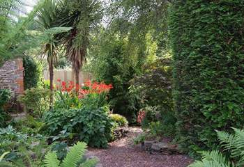The fully enclosed garden is magical, with a hidden seat around a corner by the brook, as well as the patio outside the cottage.