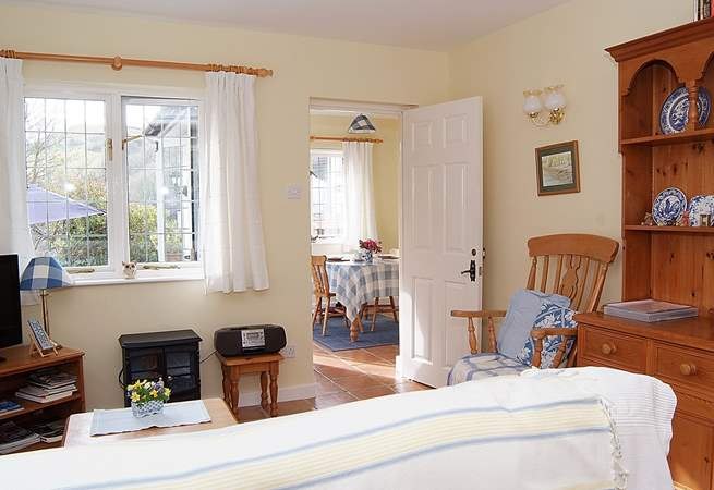 Looking across the living-area towards the dining-room/garden-room in this bright and cheerful cottage.