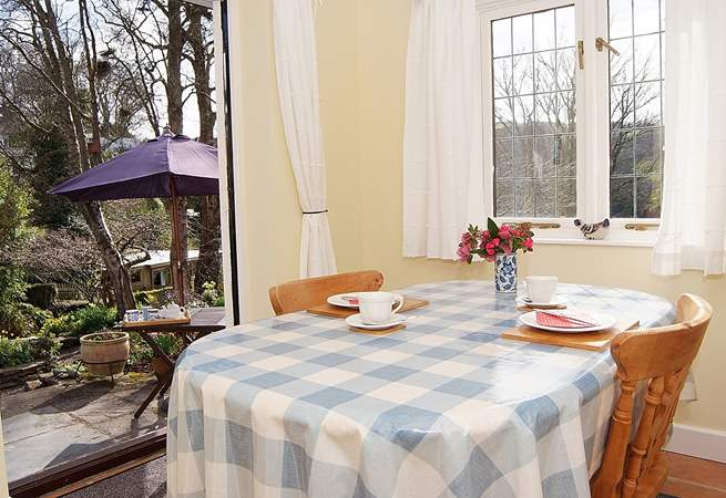 With windows on two sides and French doors to the garden, the dining-room is a bright and sunny room.
