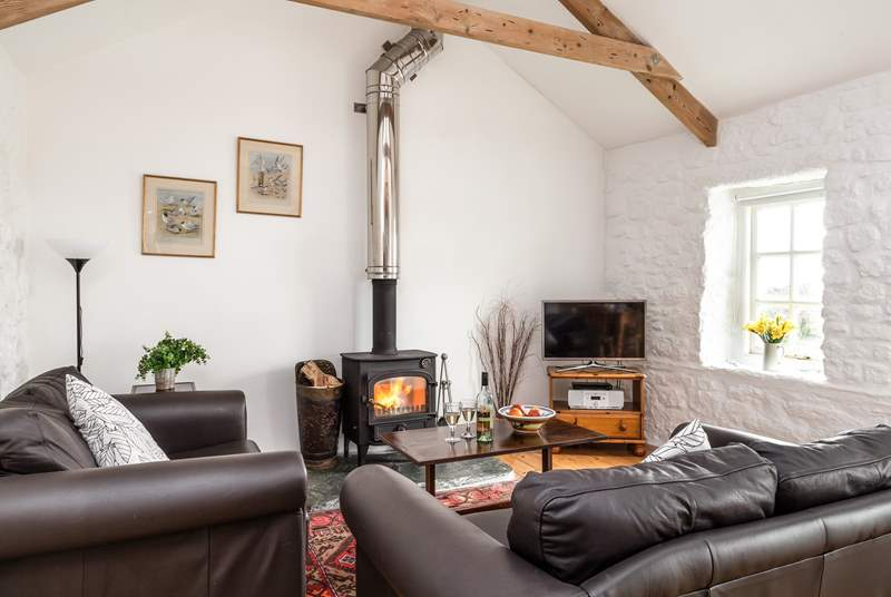 Sink into the sofas in front of the wood-burner.