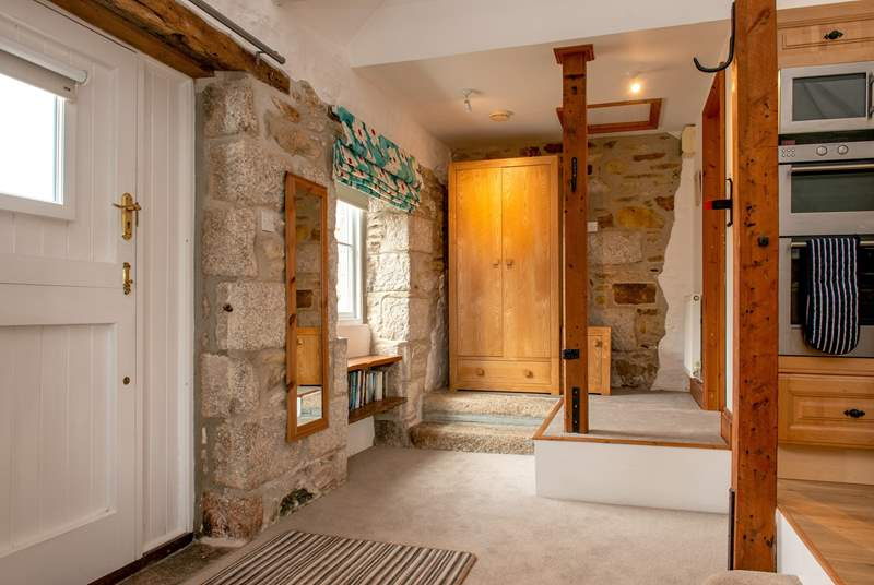 The bathroom is up the two steps in this quirky property.