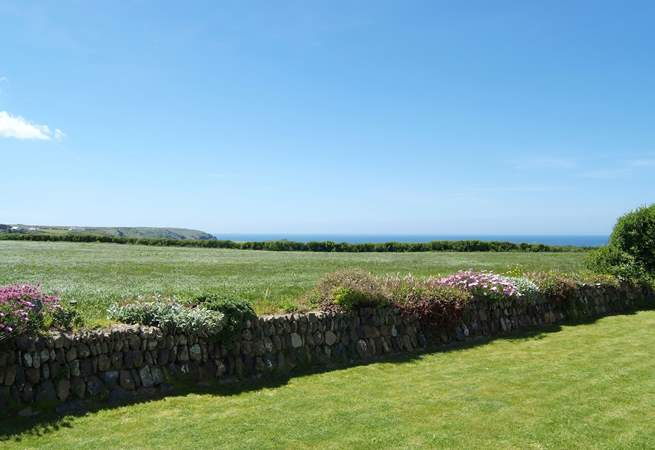 The fabulous view across the fields to the sea from the back garden.