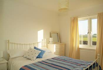Bedroom 1 has a lovely white metal-framed double bed.