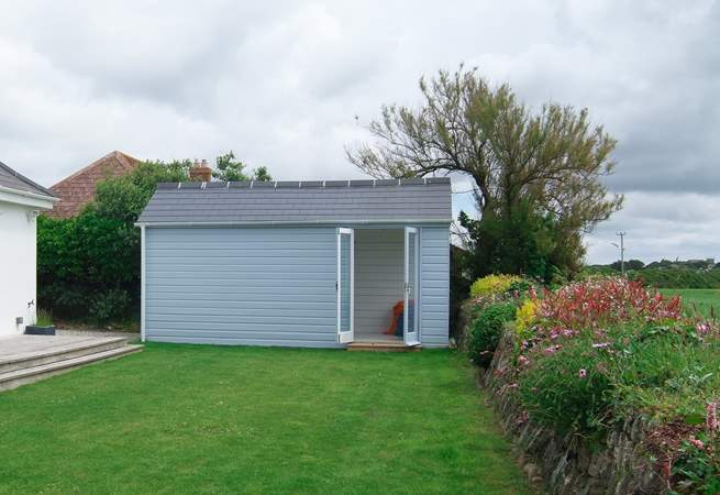 The garden shed has now been replaced with a fab cabin, somewhere to relax and enjoy the view.