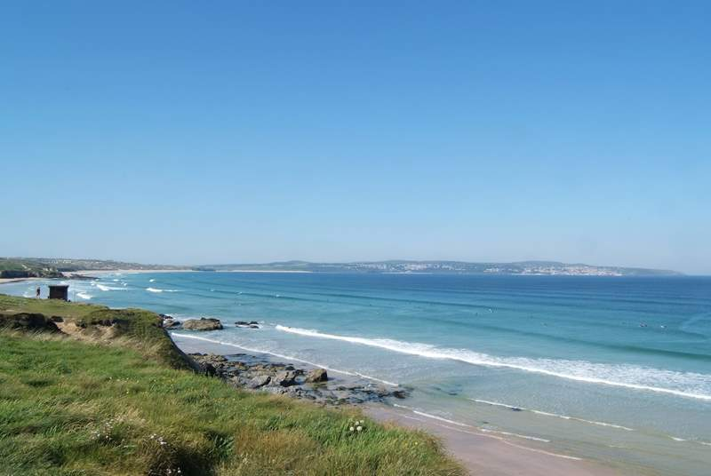 The magnificent view from the coastal footpath at Godrevy, across to St Ives at the far end of the bay.