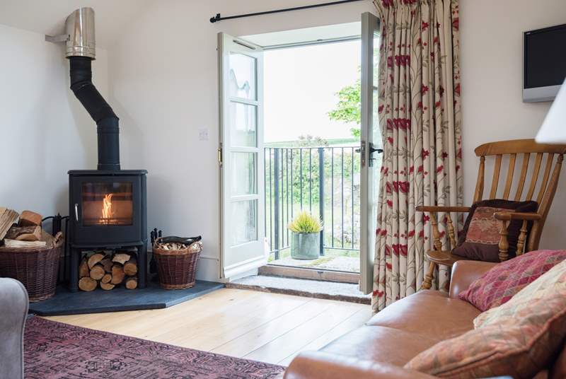 There are French doors at one end of the open plan living-room.