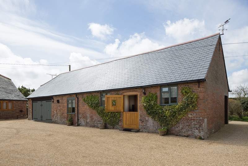 The Stables offers plenty of level parking, surrounded by beautiful gardens, the owner's house is to the left.