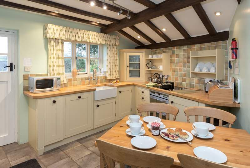 The farmhouse-style kitchen is very well-equipped and feels so welcoming when you step inside.