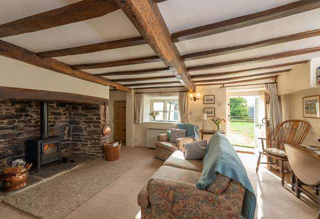 The sitting-room has a fabulous inglenook fireplace and a door that takes you out to the patio and garden.