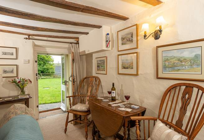 There is an additional dining-table in the sitting-room for cosy suppers with the wood-burning stove lit.