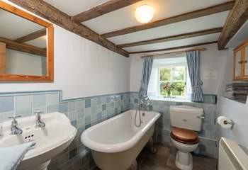 The ground floor bathroom has a lovely roll top bath and a hand held shower.