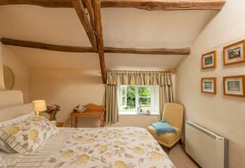Both the master and twin bedrooms look out over the pretty garden and the view across the valley beyond