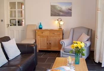 The cottage is very light and welcoming. With the choice of a two seater sofa and comfortable armchair.