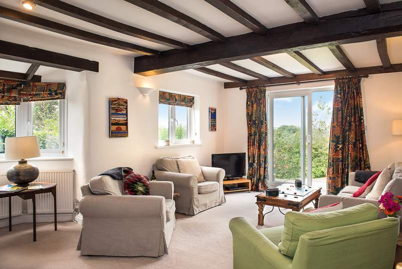 The large sitting-room enjoys views over the garden and undulating countryside.