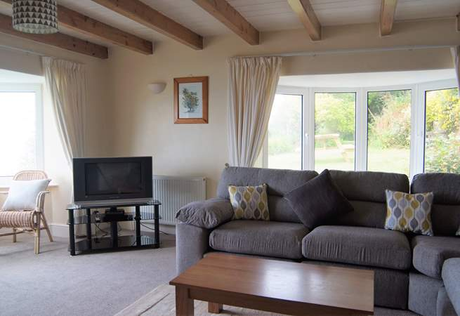 Comfortable and spacious, the large sitting-room has fabulous sea views.