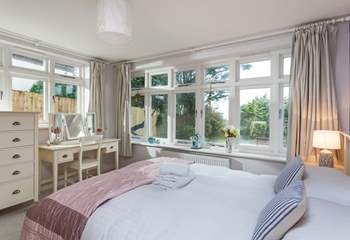 The pretty downstairs double bedroom with en suite.