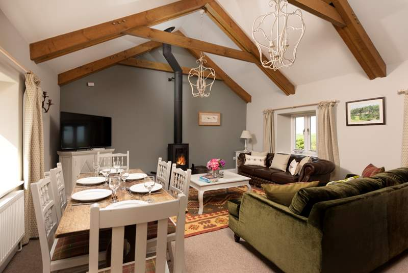 Room to relax and room to dine in this gorgeous living and dining space with a cosy wood burner for those cooler days and nights.