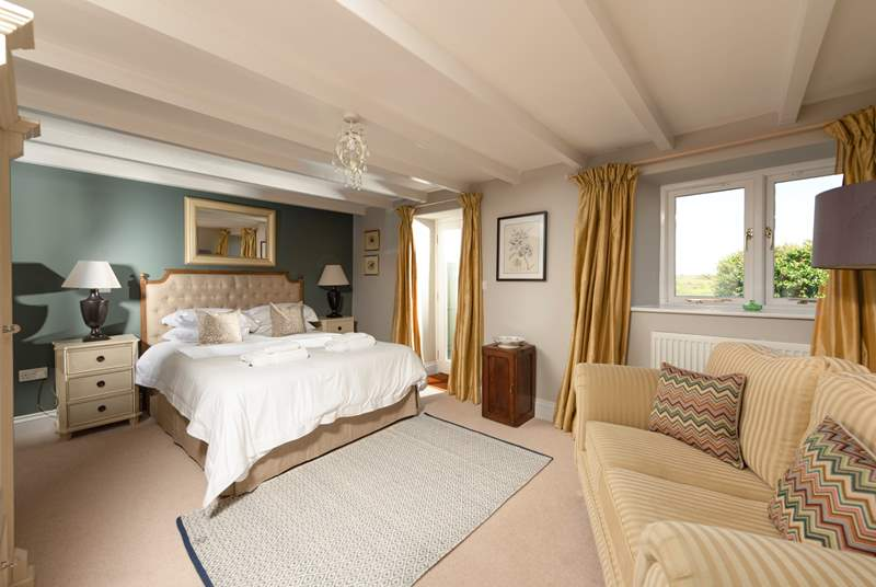 Your gorgeous and spacious master bedroom with en suite and a door directly onto the garden.