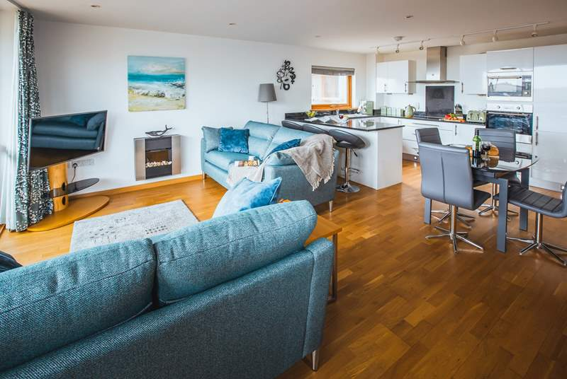 The open plan living space is open and bright, the perfect place to relax.