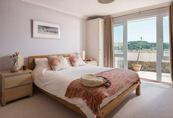 The master bedroom has double doors to the terrace.