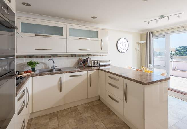 The well-equipped kitchen even has sea views.