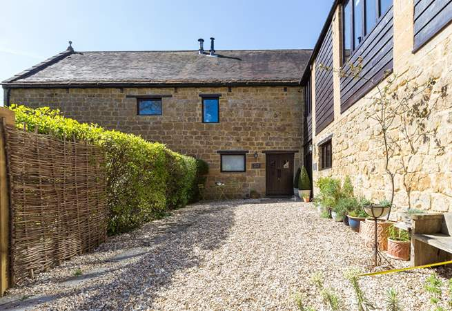 Flax Barn is this corner property in the historic Priory Barns development of traditional stone buildings. There is private parking for you.