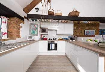There is a wonderful new contemporary kitchen with a view out over the fields across the road.