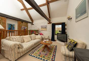 The open plan first floor has high ceilings and beams giving this space plenty of character.