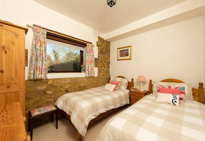 This is the twin bedroom which looks out over the courtyard towards the garden.