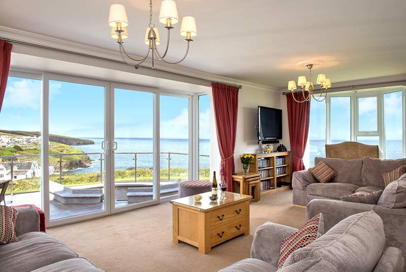 The large spacious sitting-room takes full advantage of the view.