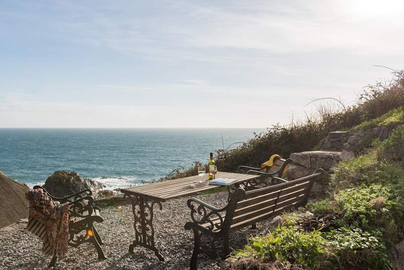 The steep terraced garden has spectacular views across the village and the cove and is accessed via steep stone steps to the rear of the cottage.